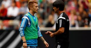 Germany coach Joachim Low talks to  Marco Reus during a training session earlier this week. Photo: Ina Fassbender/Reuters