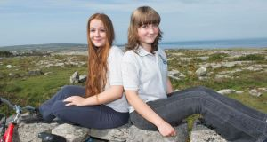 Inis Mór twins Macha and Surnaí Ó Maoldhia during an eco-tour of the island on Thursday. Photograph: Andrew Downes.
