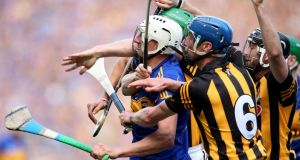Kilkenny's Paul Murphy and Brian Hogan get to grips with Patrick Maher of Tipperary during the All-Ireland hurling final. Photograph: Dan Sheridan/Inpho