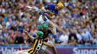 Tipperary's Séamus Callanan tussles with goalkeeper Eoin Murphy and Joey Holden of Kilkenny during yesterday's All-Ireland final draw at Croke Park. Photograph: Ryan Byrne/Inpho