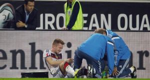 Germany's Marco Reus receives medical treatment towards the end of Germany's win over Scotland. Photograph: Ina Fassbender/Reuters