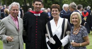 Louise Richardson (second right) with her parents, Arthur (left), and Julie (right), with Irish golfer Pádraig Harrington (centre) when St Andrews conferred an honorary degree on him in 2010