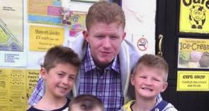 Jonathan O'Driscoll (22) with his younger twin brothers, Patrick and Tommy (9).