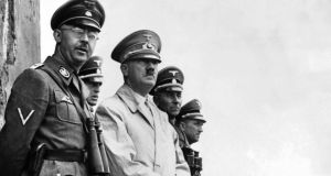Third Reich: Heinrich Himmler, head of the Gestapo, stands next to Hitler to watch a parade of Nazi storm troopers in 1940. Photograph: CIA/Reuters
