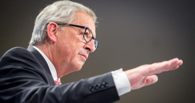 European Commission president elect Jean-Claude Juncker gestures as he addresses the media on the attribution of portfolios to the Commissioners-designate at the European Commission headquarters in Brussels.