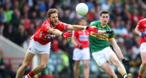 Cork's Eoin Cadogan challenges Paul Geaney of Kerry during the Munster senior championship final at Pairc Ui Chaoimh in Cork last July. Photograph: Cathal Noonan/INPHO
