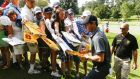 Rory McIlroy signs autographs for fans by the second green during practice for the Tour Championship at East Lake Golf Club in Atlanta, Georgia, yesterday. Photograph: Tannen Maury/EPA