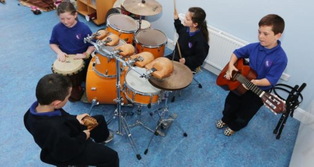 Volunteers from Our Lady of Lourdes National School, Patrick Nolan (8) on guiro, Ciaran Bannon (8) on djembe, Zoe Malone (8) on drums and Lee Nolan (8) on guitar, attend the Blue Box creative therapies. Photograph: Liam Burke/Press 22