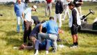 Fabrizio Zanotti of Paraguay is attended to by medical staff after being struck with a ball during Day One of the KLM Open at De Kennemer Golf and Country Club in Zandvoort. Photograph: Dean Mouhtaropoulos/Getty Images