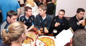 Taking a break: All-Ireland football champions Dublin enjoy some homecoming pizza in 2011. Photograph: Morgan Treacy/Inpho