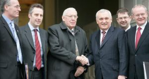 Ian Paisley and Bertie Ahern meeting at the British irish Council Summit in 2008, flanked by (from left) Gerry Kelly, Ian Paisley Jr, Eamon O'Cuiv and Martin McGuinness. Photograph: Eamonn Farrell/Photocall Ireland.