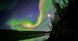 Swirls of green and red appear in an aurora over Whitehorse, Yukon on the night of September 3rd, 2012 in this NASA handout image. Photograph: Reuters/courtesy of David Cartier Sr/Nasa handout