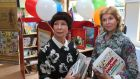 Ludmila Snigireva, head teacher of Paper Crane, with Olga Butskaya, organiser of 'Today Children, Tomorrow a Nation', while preparing the Russian-language library at Scoil Bhride in Shantalla, Galway. Photograph: Joe O'Shaughnessy/The Irish Times