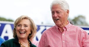 Former US secretary of state Hillary Clinton and her husband, former US president Bill Clinton, at the Harkin 'steak fry' in Indianola, Iowa. Photograph: Reuters/Jim Young