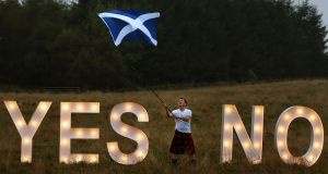 Businessman Jon Gamble asks the question Yes or No with illuminated signs near Dunblane, Scotland, ahead of voting in the Scottish Referendum on September 18th. Photograph: Andrew Milligan/PA Wire