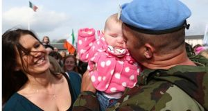 Peacekeeper's return ... Cpl John McAllister from Newbridge with his daughter, Sadie  and partner Sinead White   in April  at Casement Aerodrome, Baldonnel on his return from a six-month tour   to the Golan Heights, Syria with the United Nations Disengagement Observer Force. Photograph: Colin Keegan, Collins Dublin.