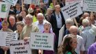 A rally in July outside the Dail to protest about the proposed amalgamation and changes to the Leader scheme, centralising control of rural development in new local government structures. Photograph: Alan Betson / The Irish Times
