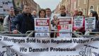"Homeowners whose mortgages have been bought by so-called ""vulture funds"" protesting outside Leinster House yesterday. Photograph: Alan Betson."