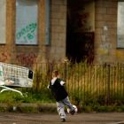 A boy plays football in  the Govan area of Glasgow. Photograph: Jeff J Mitchell/Getty Images