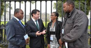 Senator Ronan Mullen with asylum seekers Maurice Kiesse, Patricia Murambinda and Gerald Musekiwa before his Private Members' motion in the Seanad. Photograph: Alan Betson