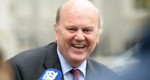 "Pictured after today's publication, Minister for Finance Michael Noonan said the turnaround ""is a direct consequence of the policies pursued by this Government"" . Photograph: Eric Luke / The Irish Times"