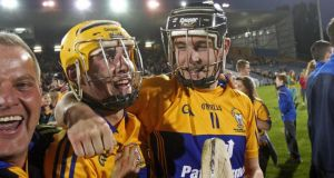 Tony Kelly and Colm Galvin of Clare celebrate victory at the end of the All-Ireland Hurling Under-21 Championship Final at Semple Stadium in Thurles. Photograph: Donall Farmer/Inpho