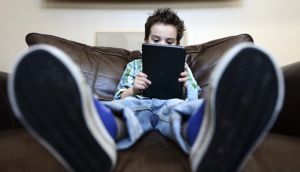 In too deep: parents need to monitor how much time their children spend in front of screens. Photograph: Ben Solomon/New York Times
