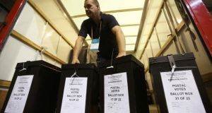 A man carries ballot boxes at a counting centre in Edinburgh. Photograph: Paul Hackett/Reuters.