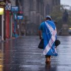 The blues ... A dejected 'Yes' supporter in Edinburgh makes his way home in the early hours after Scotland voted  (Photo:Stefan Rousseau/PA Wire)