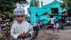 A young Muslim boy photographed outside the Mosque in the Muslim district of Mandalay, Myanmar's second largest city. Photograph: Brenda Fitzsimons