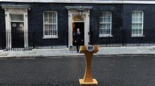 "Britain's prime minister David Cameron arrives to speak to the press outside number 10 Downing Street following the counting of votes in the Scottish referendum. He welcomed the ""clear result"". Photograph: Facundo Arrizabalaga/EPA"