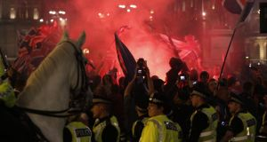Police stand in front of Unionists gathered in George Square, Glasgow, last night. Photograph: Danny Lawson/PA Wire