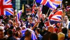 Pro-union protestors wave union flags  during a demonstration at George Square. Photograph: Cathal MacNaughton/Reuters