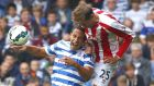 Queens Park Rangers' Rio Ferdinand (left) is beaten to the ball by  Stoke City's Peter Crouch  at Loftus Road. Photograph: Eddie Keogh / Reuters