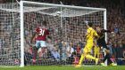 West Ham United's Diafra Sakho (unseen) scores a goal against Liverpool  at the Boleyn Ground. Photograph: Andrew Winning / Reuters
