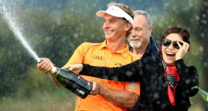 Joost Luiten of the Netherlands sprays champagne following his victory at the  Wales Open at Celtic Manor. Photograph:  Richard Heathcote/Getty Images