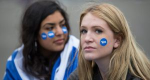 Dejected Yes supporters in George Square, Glasgow, last Friday. Photograph: EPA/Robert Perry