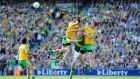 Donegal's Frank McGlynn, Rory Kavanagh and Eamonn McGee, with Kieran Donaghy of Kerry during yesterday's All-Ireland final at Croke Park. Photograph: Cathal Noonan/Inpho