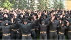 More than 500 employees dressed in full Batman costumes gathered outside the headquarters of oil and gas company, Nexen, to raise money for charity and break a world record in the process. Video: Reuters