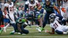 Marshawn Lynch dives over the line  to score  Seattle Seahawks'  winning touchdown in overtime against the Denver Broncos at CenturyLink Field  in Seattle, Washington. Photograph: Otto Greule Jr/Getty Images