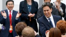 'Ed Miliband has been forced to return to Labour's hallowed ground of the National Health Service in a bid to damage the Conservatives in England, along with higher taxes on multi-million pound properties.' Above, the Labour leader  arrives at the party's annual conference in Manchester, yesterday. Photograph: Suzanne Plunkett/Reuters