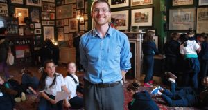Curator Mark O'Neill at the Little Museum of Dublin on St Stephen's Green with pupils from St Pius X Girls' National School. Photograph: Simon O'Connor