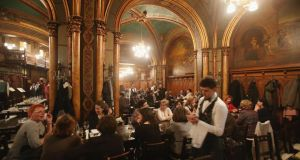 The bustling Caru' cu Bere (Friends with Beer), the city's oldest restaurant, opened in 1899. Photograph:  Sean Gallup/Getty Images