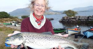 Mariet Timmermans from Holland with an excellent sea trout of 4lb caught on Lough Currane, Waterville, Co Kerry, on the fly. photograph: vincent appleby