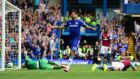 Diego Costa of Chelsea celebrates after scoring his team's second against Aston Villa at Stamford Bridge. Photograph: Jamie McDonald/Getty Images