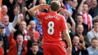 Liverpool's Steven Gerrard celebrates after scoring against bitter derby rivals Everton. But critics have wondered whether he has the mobility to cope with a league that is speeding up as he is slowing down. Photograph: Peter Byrne/PA