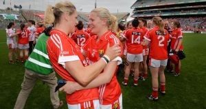 It was Cork versus Dublin in the All-Ireland ladies senior football championship final in Croke Park yesterday. Cork took the title in a dramatic finish at 2-13 to Dublin's 2-12. Angela Walsh and Deirdre O'Reilly from Cork celebrate their win. Photograph: Alan Betson/The Irish Times