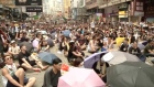 Protestors continue to fill the streets fo Hong Kong's business district in a pro-democracy protest. Video: Reuters