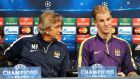 Manchester City manager Manuel Pellegrini (left) and goalkeeper Joe Hart during a press conference held at the Etihad Stadium today. Photograph: Peter Powell / EPA