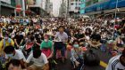 Thousands of protesters occupy a main street at Mongkok shopping district in Hong Kong. Photograph:  Reuters